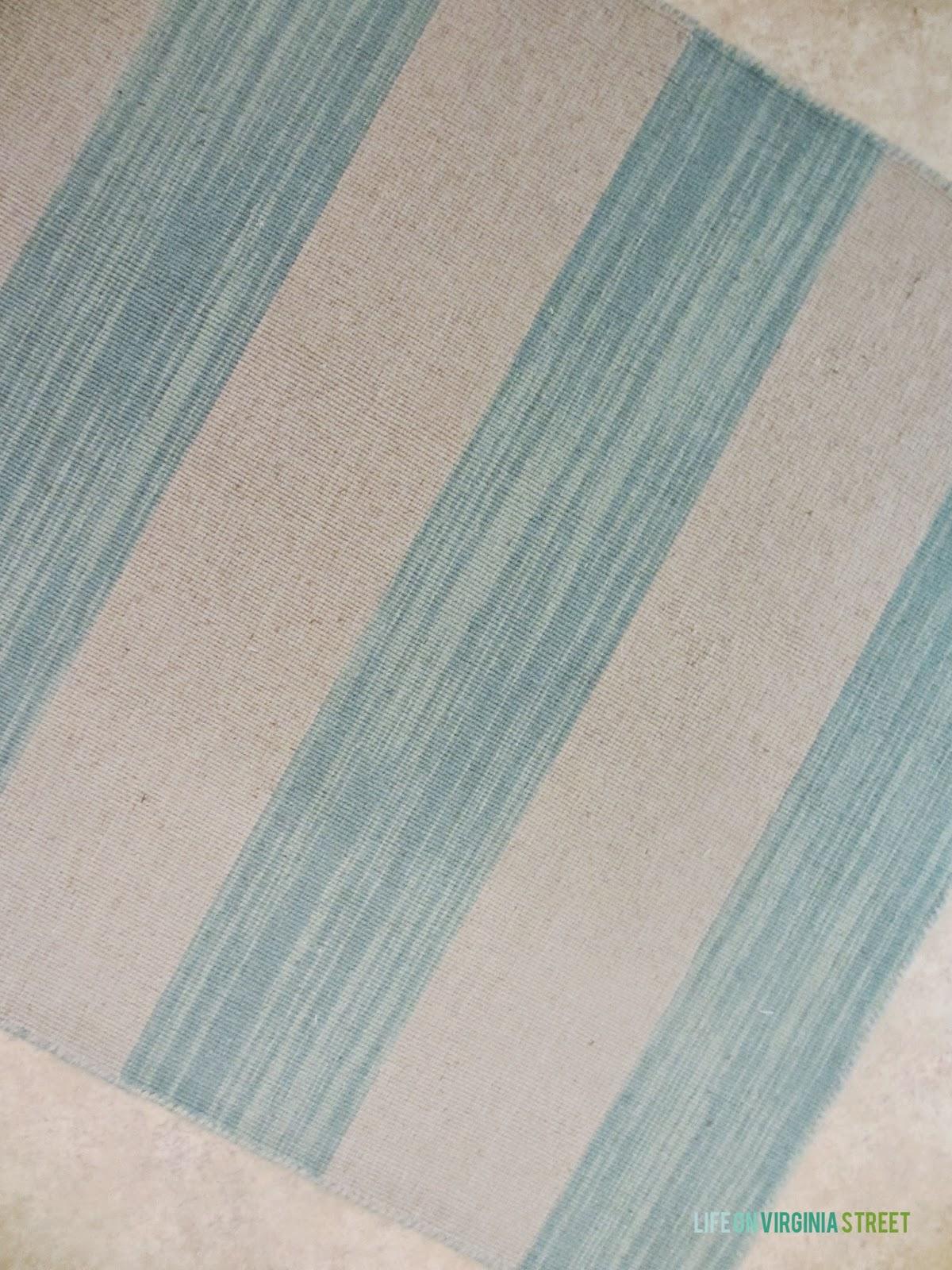 Striped aqua and beige rug