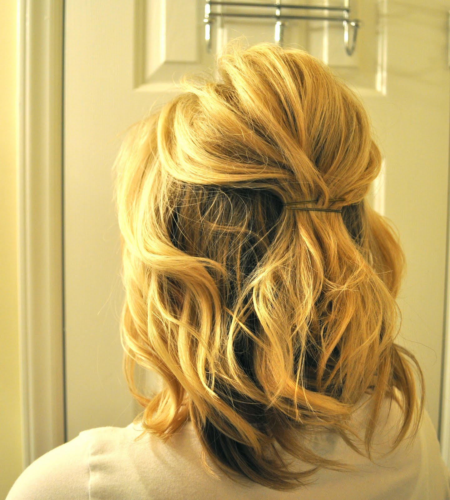 Half up to full updo the small things blog 4 loosely grab a section on one side of your head and pull it back and over the bobby pins in the center essentially you are covering those first pins so solutioingenieria Images