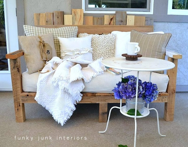 Pallet wood sofa and bistro table with hydrangeas on FunkyJunkInteriors.net