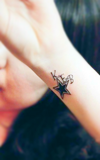 Star tattoo on the wrist