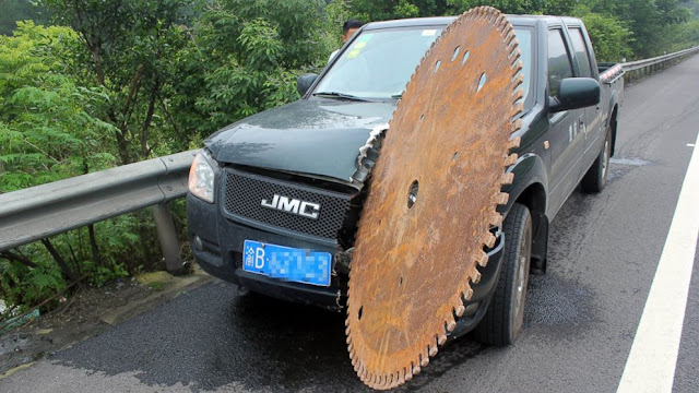 Chinese Man Escapes Unhurt After Huge Saw Blade Slices Truck