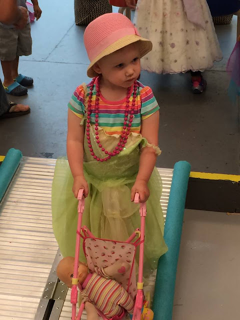 hat, stroller, doll, make believe, pretend play, beads, necklace, dress