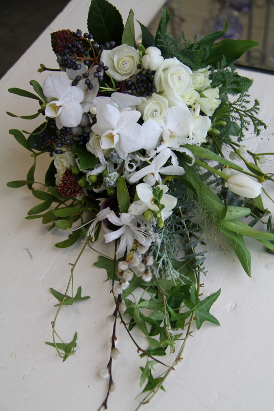 Gorgeous trailing white shower wedding bouquet including Roses