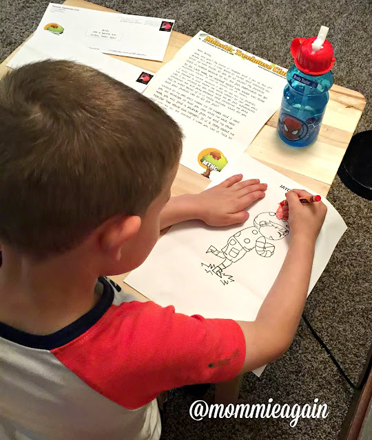 Child coloring a Monster Tree House Club color sheet
