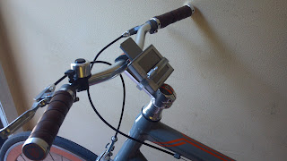 gps attached a bicycle with a hose clamp