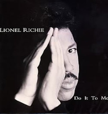 Lionel Richie eye covered Illuminati style