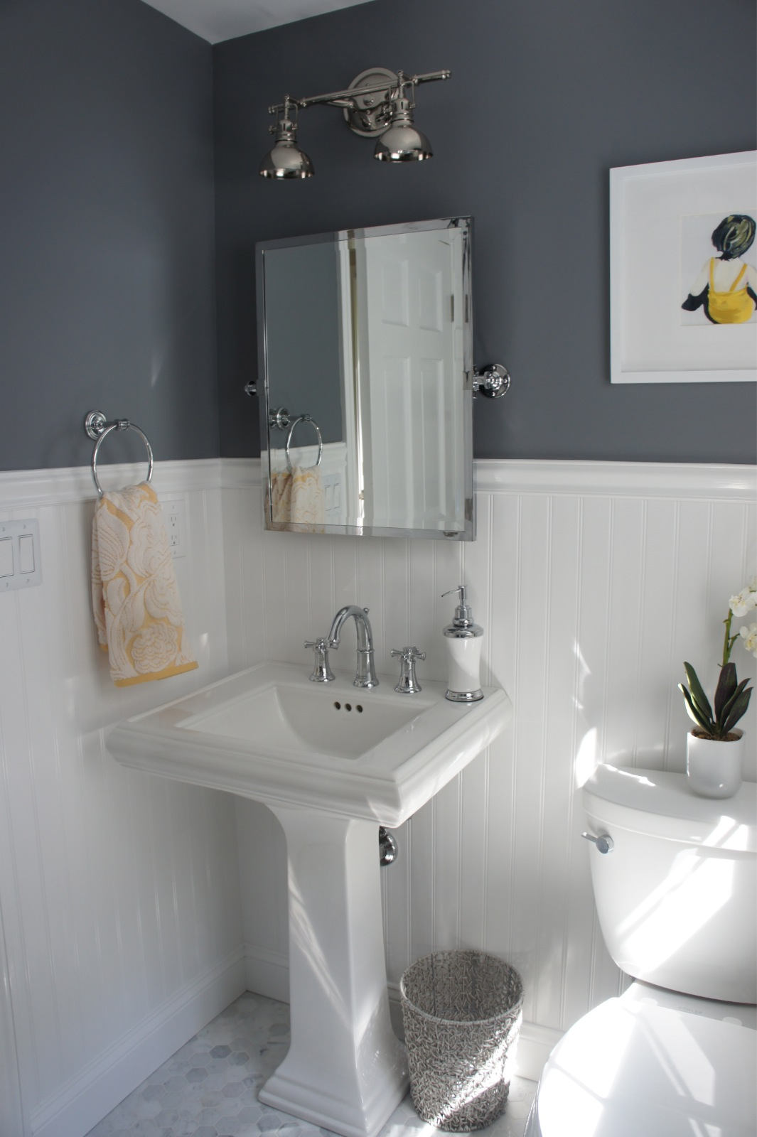 Home with baxter house tour week 5 half bath laundry for Wainscoting bathroom ideas