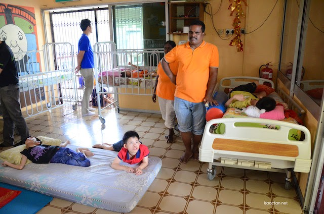 The good people from PPKKCK helping to care for the disabled children