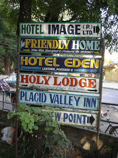 list of hotels in Pokhara posted on tree