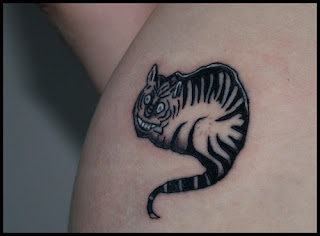 smiling black cat tattoos
