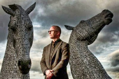 Artist Andy Scott with his 300-tonne Kelpies at The Helix park in Falkirk Photograph: Julie Howden