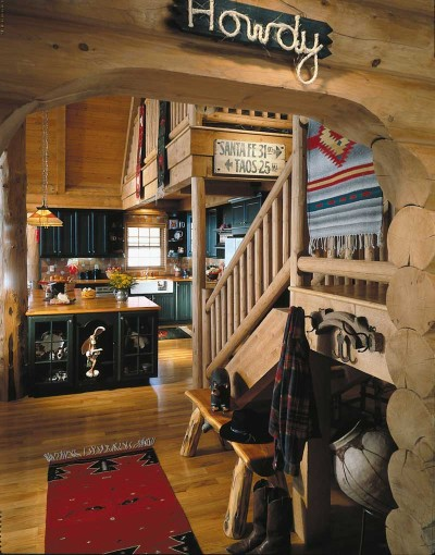 using some western bedding and throwing down some western rugs will get you heading in the right direction look for bold colored quilts and old saddle - Western Interior Design Ideas