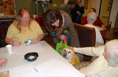 Lisa Locke and her dog Moon visit the Emeritus Senior Living's recreation room, Vancouver, Wash.