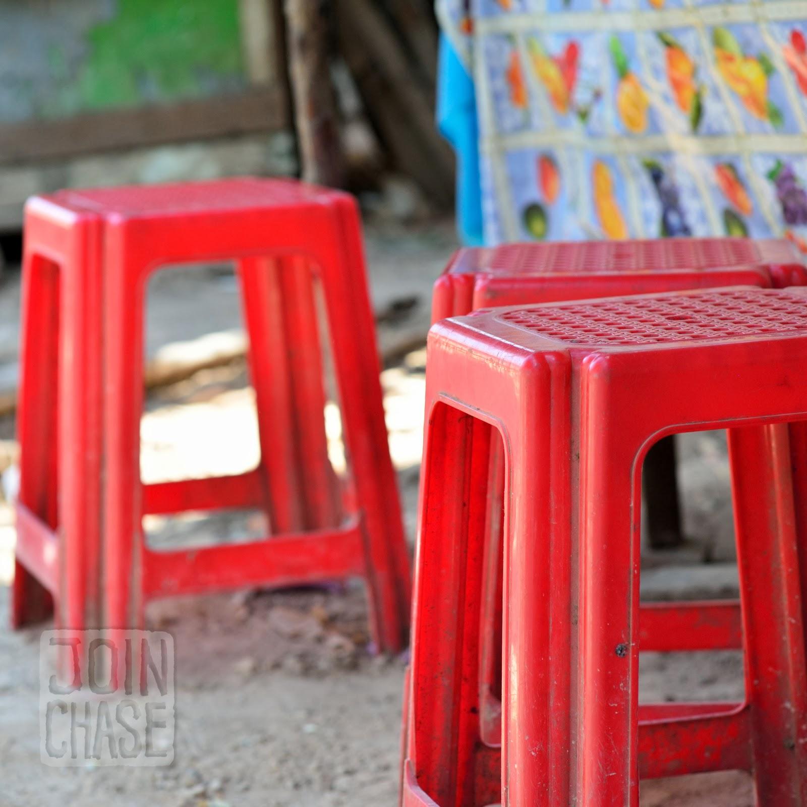 Plastic stools at a roadside restaurant in Myanmar.