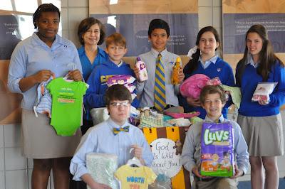 Montgomery Catholic Middle School Students Make Donation to COPE 1