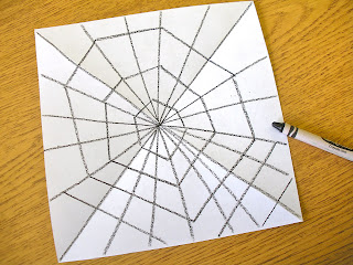 Student drawing lesson on making a web