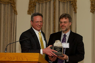 Virginia State Geologist David Spear presents the award to Tim Aike