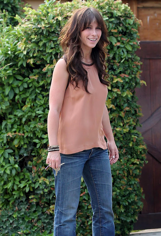 Jennifer Love Hewitt in front of her home