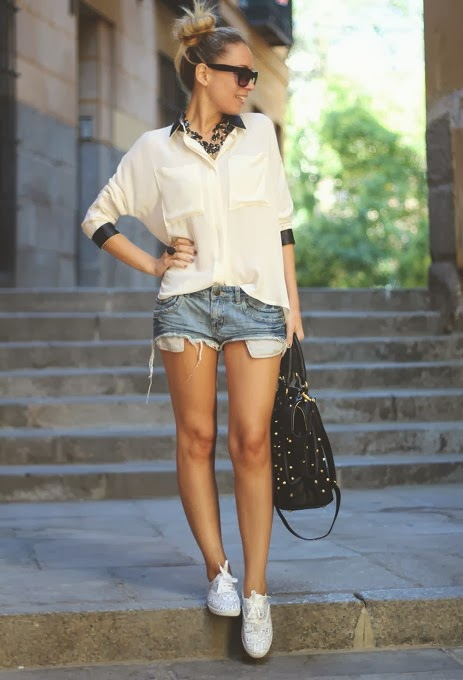 White Shirt and Blue Jeans Short with Big, Black Handbag. Adorable Fashion Style for Warmer Weather
