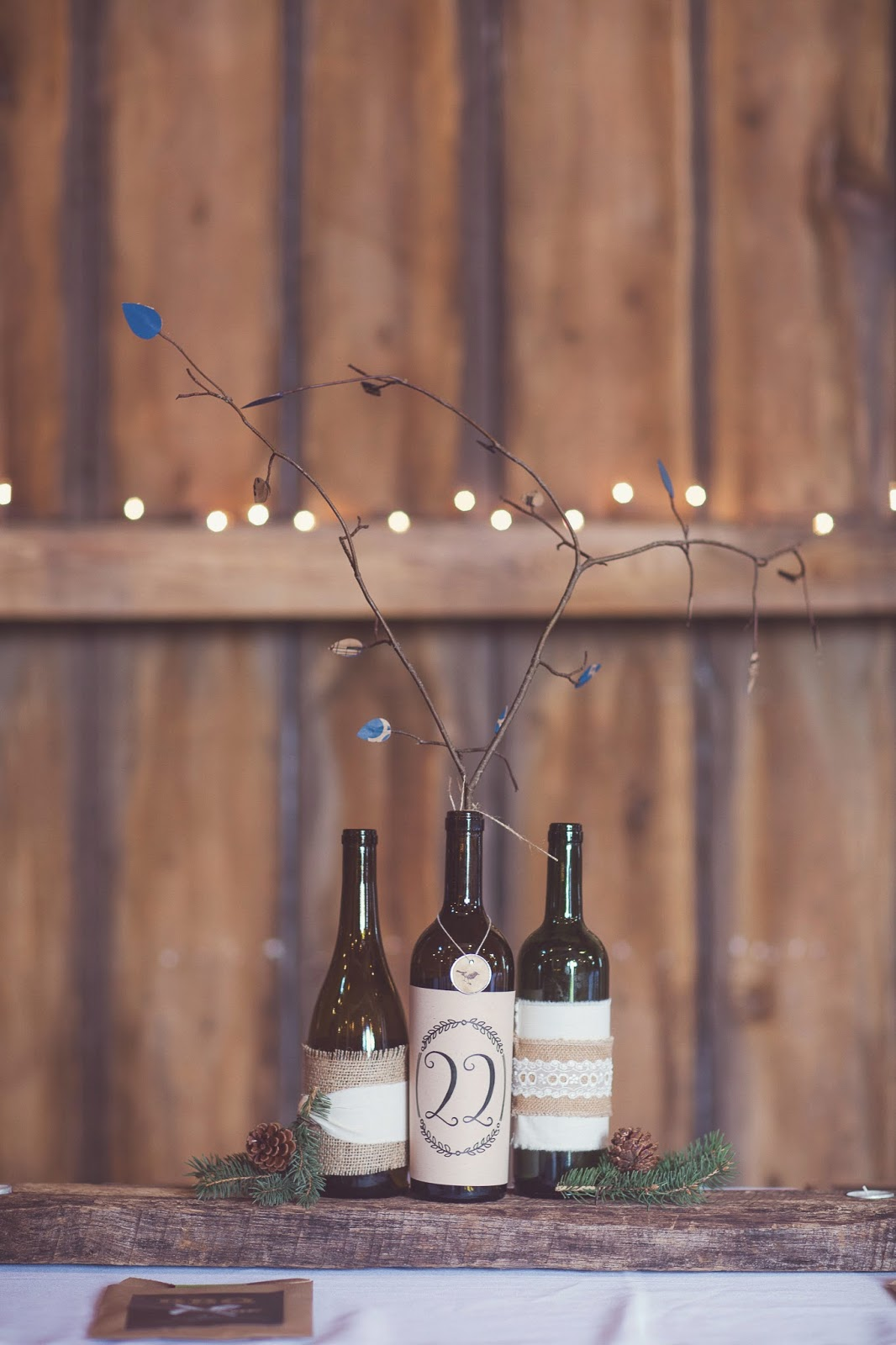 wedding reception rustic wine bottle centerpieces