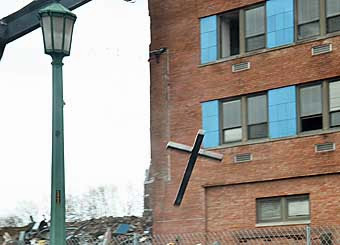 Newzjunky Publishes Photo of Cross Falling Off Mercy