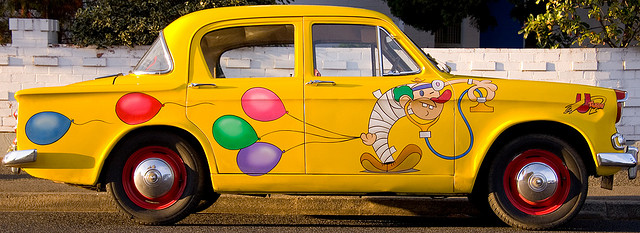 A yellow clown car
