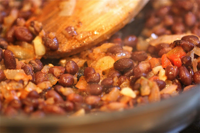 The meat has been replaced with black beans, sautéed with onion and ...