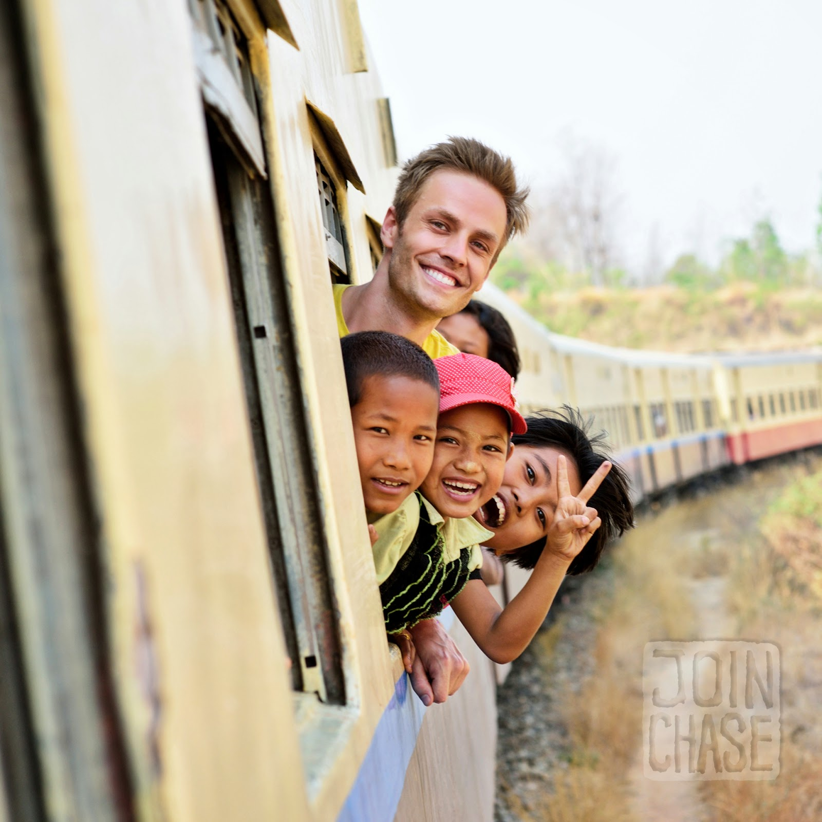 Posing for a photo with children on the train from Yangon to Bagan, Myanmar.
