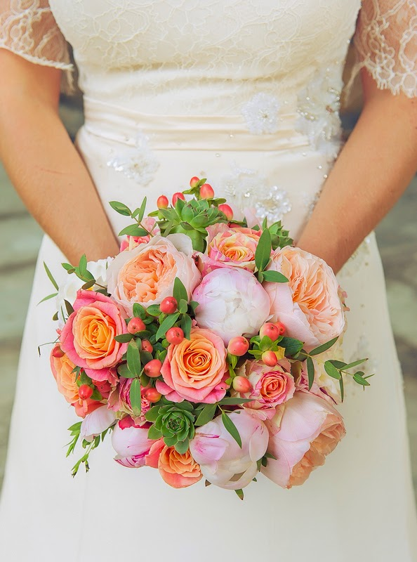 Glorious wedding bouquet, featuring colouful roses