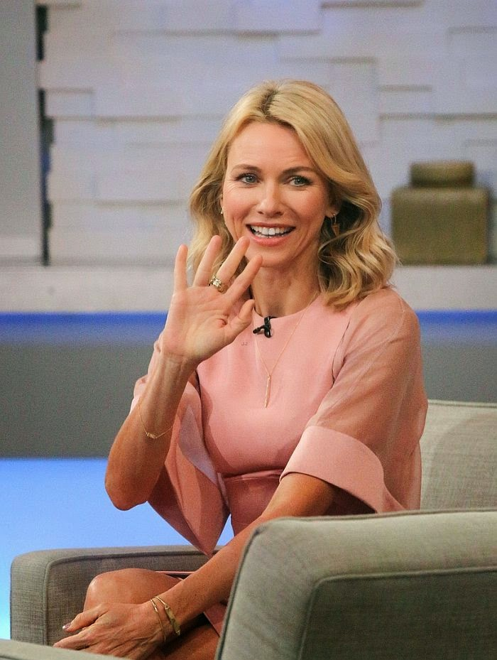 Style skills or what! Her studio looks are very classic and sophisticated. And we are definitely full of praise for this one as Naomi Watts arrived by herself to the Good Morning America studios at New York, USA on Monday, October 13, 2014. The 46-year-old looked chic in a beauty pink shirt dress with a smart light gray coat and a matching cute of Christian Louboutin high heels.