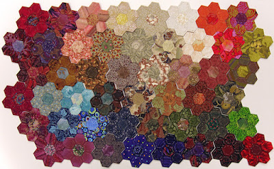 Robin Atkins, hexie quilt, 49 stitched hexie flowers made with Thom Atkins fabric scraps