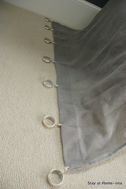 spacing out curtain rings with clips along a sheer drape
