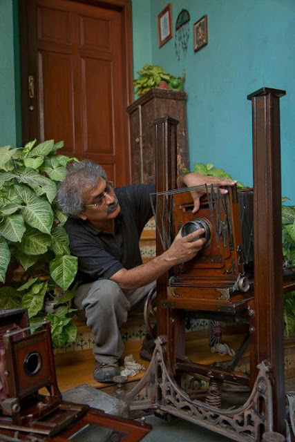 Last weekend I visited  INDIA PHOTO ARCHIVE FOUNDATION and it was a wonderful opportunity to know more about old technologies around Photography and the way one of the great Indian Photographers works. It was a very interactive meet with Aditya Arya, who is one of the famous Indian Photographers and popularly known for his work in 'India Photo Archive Foundation' Before I start sharing about the experience, just check out the video below -(All photographs used in this Photo Journey are picked form different websites or Aditya's Facebook Profile. So none of these are clicked by me)After reaching Aditya's place, we spent some time around his Camera Collection and the place where he has kept archives. INDIA PHOTO ARCHIVE FOUNDATION IS REGISTERED AS PUBLIC CHARITABLE TRUST, a Trust for Creation of awareness of contemporary and historical photographs, creation of archives, and highlighting the historical value of photographic archives and collections and to encourage the dissemination, access and use of such archives for academic, institutional and cultural purposes.Aditya has worked on various books and I also looked at two of his books. One was on Nagaland, where he visited many times to understand the place and people. One of his book 'HISTORY IN THE MAKING' was launched at NCPA, in presence of Bollywood Actor Anupam KherAditya Arya planned some of the exhibitions to showcase photographs clicked by the legendary photographer Kulwant Roy. Roy's collection of candid moments of Pandit Jawaharlal Nehru, Mahatma Gandhi, and other stalwarts of early 20th century India, are very well preserved by Mr Arya. Roy's collection was inherited by his nephew Aditya Arya, who himself is a professional photographerMore work by Aditya Arya can be checked at - http://www.adityaarya.com/ and to know more about him, check out http://www.adityaarya.com/#/about/bio-info-pagThe Aditya Arya Archive (http://www.adityaaryaarchive.com/) is based on the almost forgotten photographs of the importan