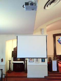 Church video system shown: high lumen projector, motorized projection screen and Pro Bose loudspeaker. speaker