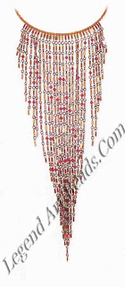 An Erickson Beamon collarette necklace with multiple strands of alternating glass crystals and bugle beads. The gilded beads and garnet crystals complement each other, especially with the dark metal plating used on the metal links. The pendant strands fall from a stiff wire neckline.