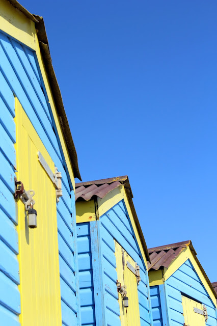 Little Hampton beach huts blue