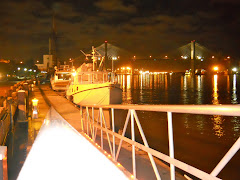 YA docked in the Savannah River at night.  Lots of lights!