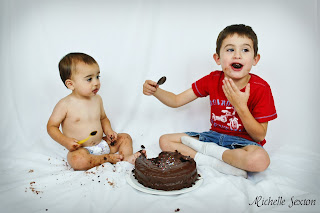 two boys eating chocolate cake
