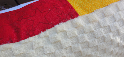 close-up of the hand stitched edge of the pillow