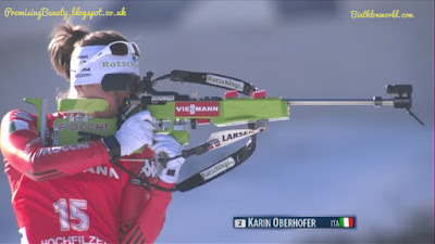 biathlon, female biathlete from italy shooting with rifle. Wintersports shown on biathlonwworld and eurosport.