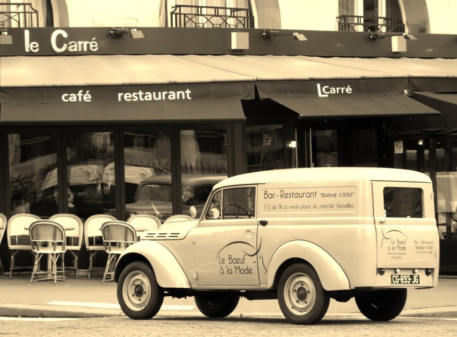 Van outside a cafe in Paris