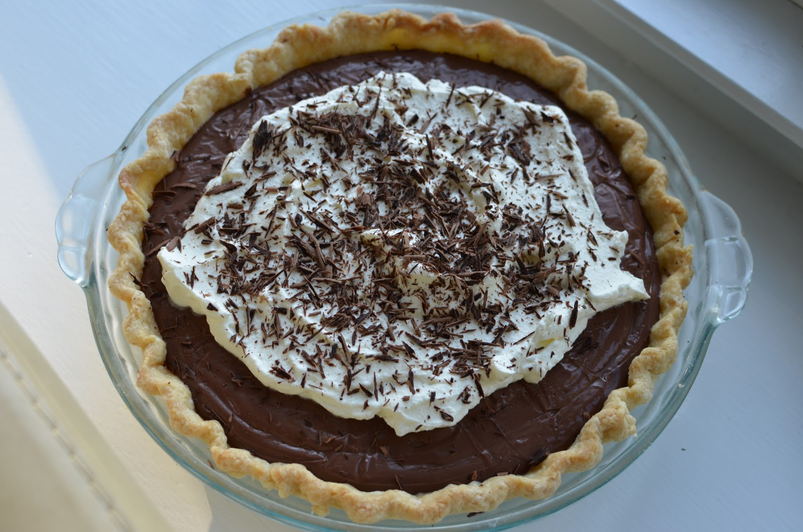 The recipe for this chocolate pudding pie comes from Smitten Kitchen .