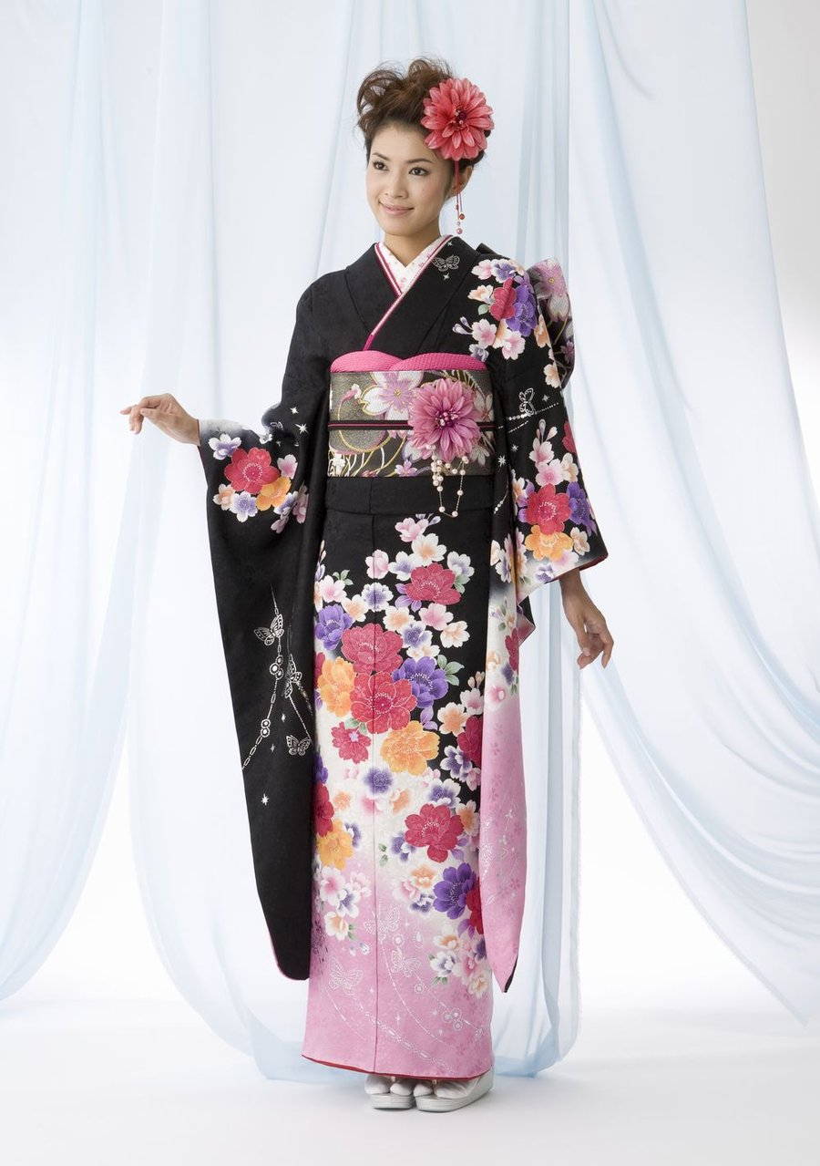Kimono definition, a loose, wide-sleeved robe, fastened at the waist with a wide sash, characteristic of Japanese costume. See more.