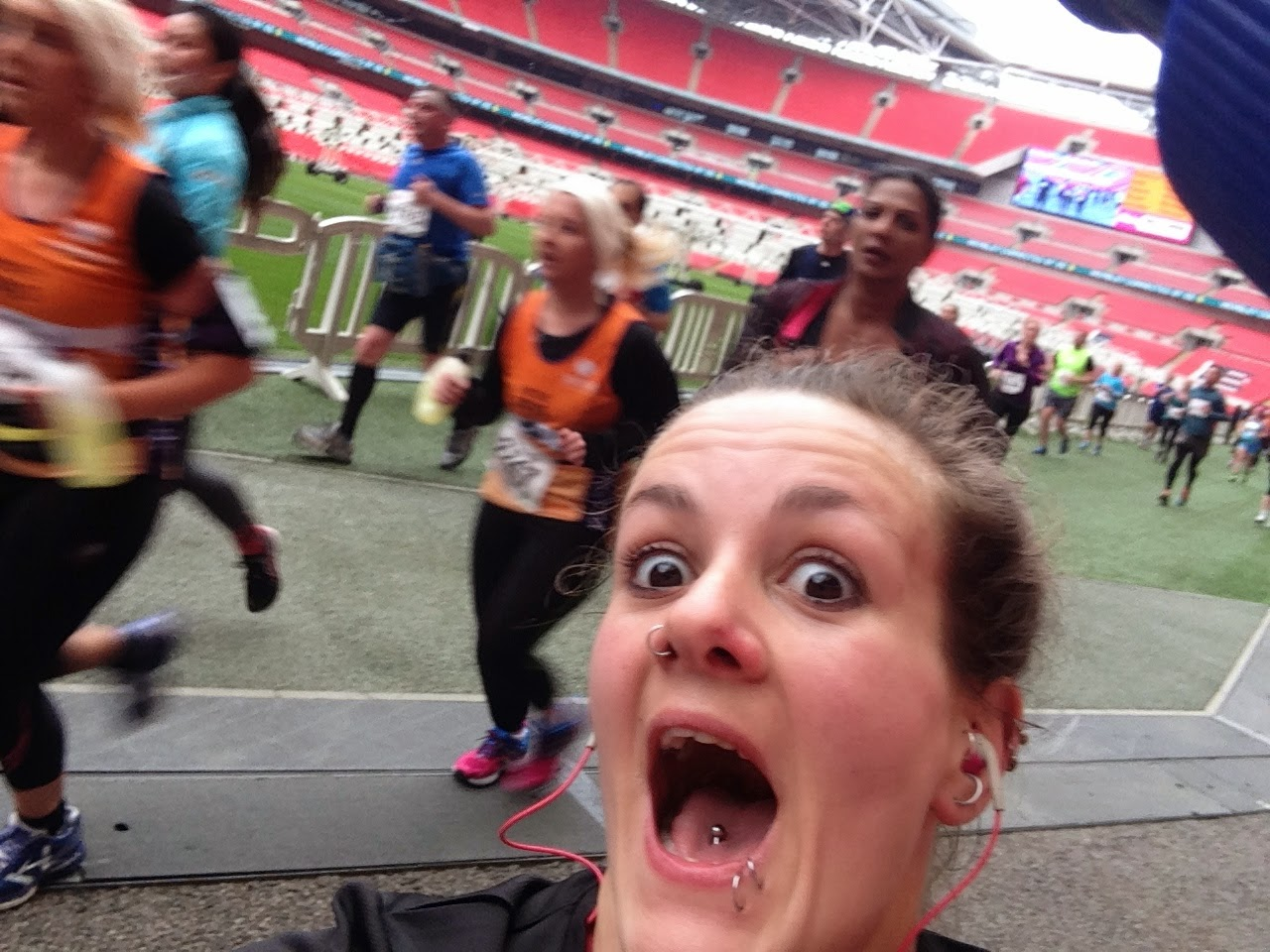 Running through Wembley Stadium at the North London Half Marathon 2015