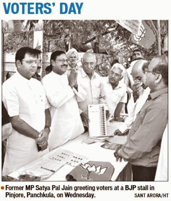 Former MP Satya Pal Jain greeting voters at a BJP stall in Pinjore Panchkula on Wednesday.