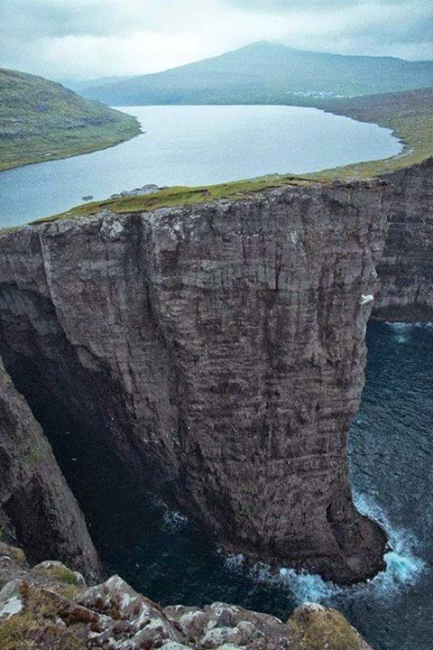 Lake over the ocean in Faroe Islands