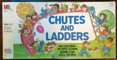 Chutes and Ladders box with watercolor kids climbing on ladders and slides