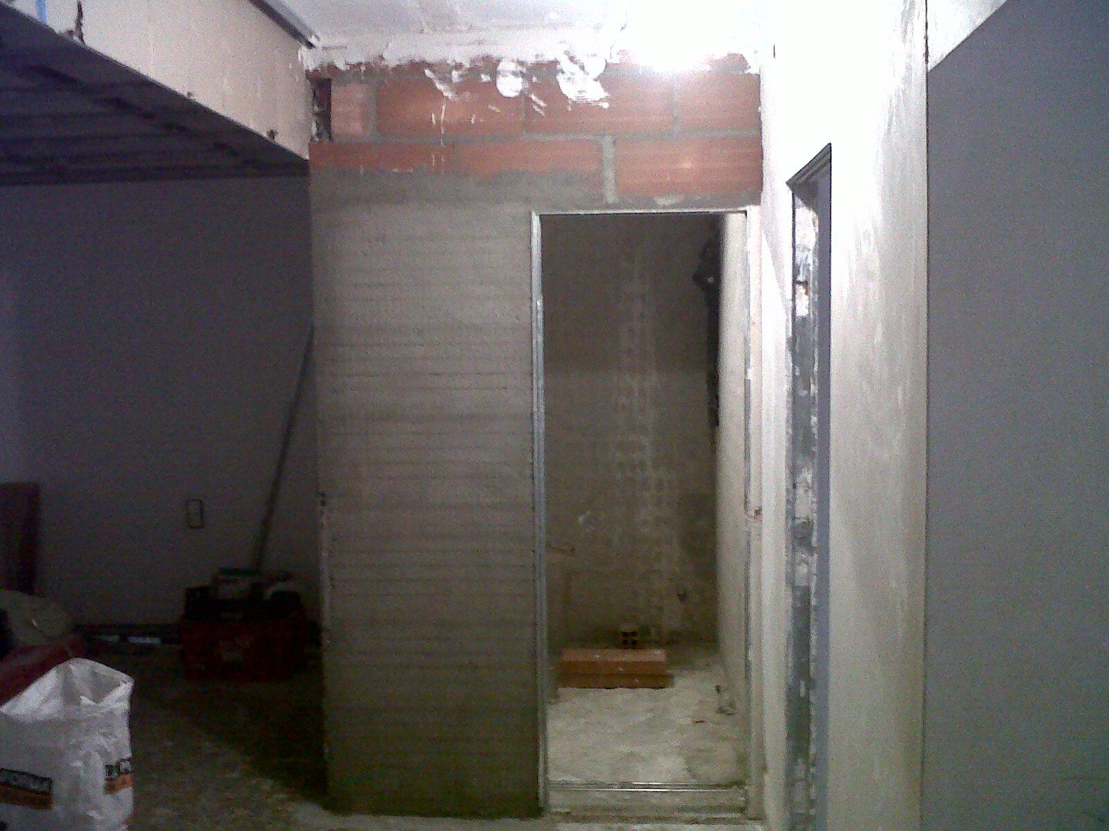 Obras y reformas reforma piso c de miquel angel - Puertas correderas empotradas en tabique ...