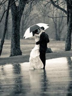 Girl kissing boy in rain love