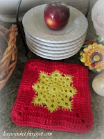 red and yellow crochet hot pad